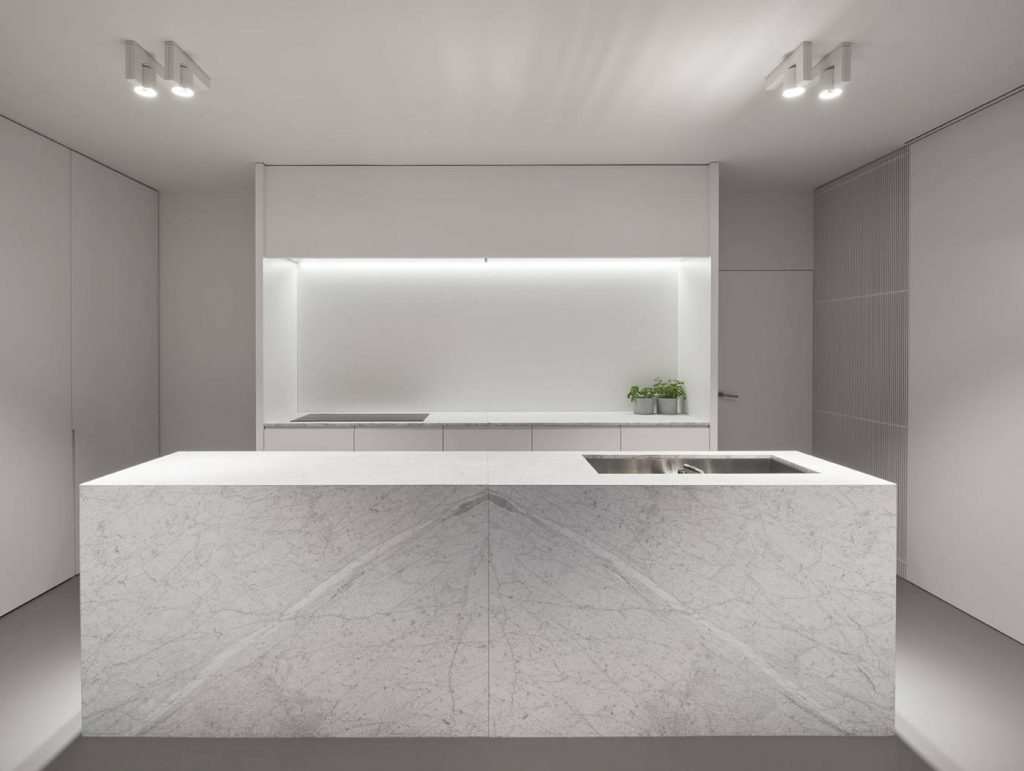 Clean white kitchen with big island