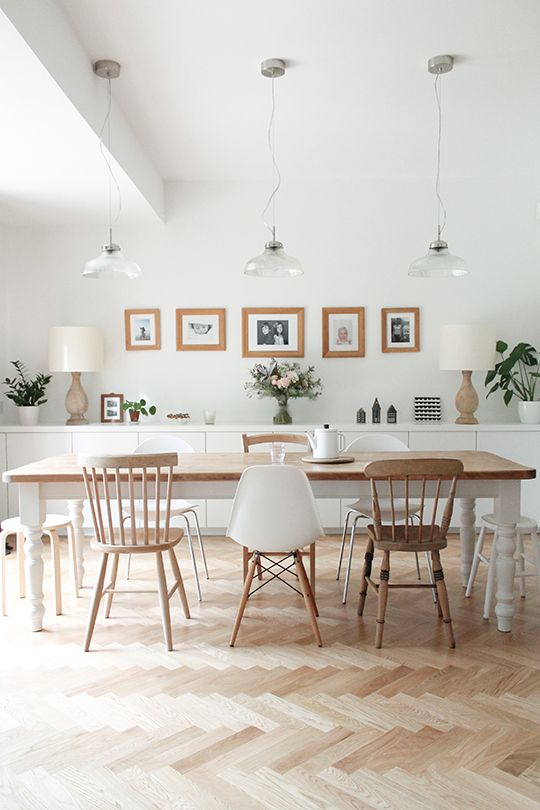 Huge light coloured wood dining table for Scandinavian-themed home