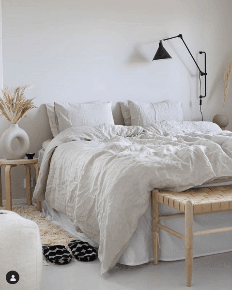 Plush pillows and bed in Scandinavian bedroom design