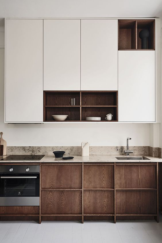 Create a big contrast with dark and light wood cabinets in Scandinavian homes