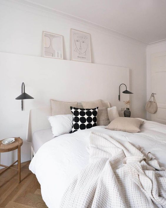 Simple Scandinavian bedroom with muted colours