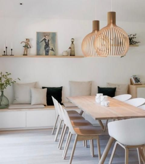 Scandinavian dining room looks great with natural hues and plush pillows