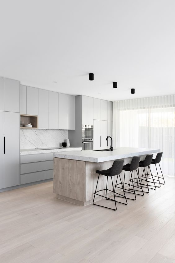 Gorgeous light grey kitchen cabinets in Scandinavian-themed home